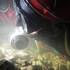 Closeup of a British cave diver in a constricted sump