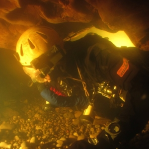A British cave diver using a custom built chest-mount rebreather