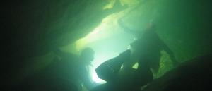 British cave divers swim down a rift passage