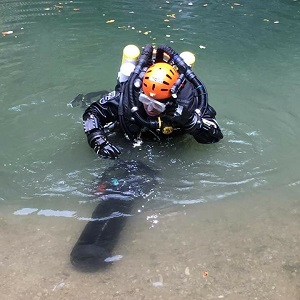 A CDG diver preparing for a long cave diver using a closed circuit rebreather and diver propulsion vehicles