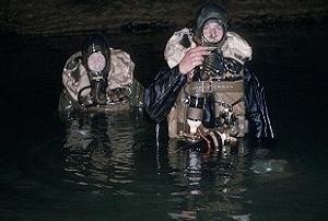 British cave divers using war surplus oxygen rebreather equipment