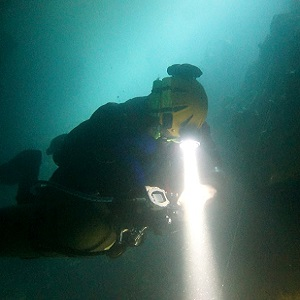 A British cave diver checks his gauges
